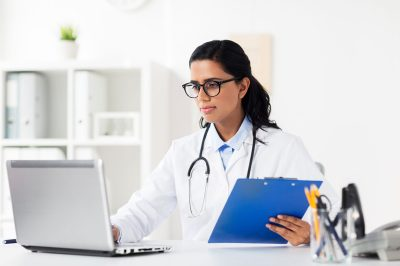 doctor-with-laptop-and-clipboard
